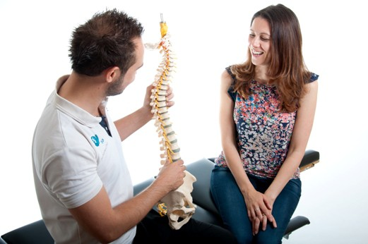 Mark Davies chiropractor in Rayleigh talking to a patient